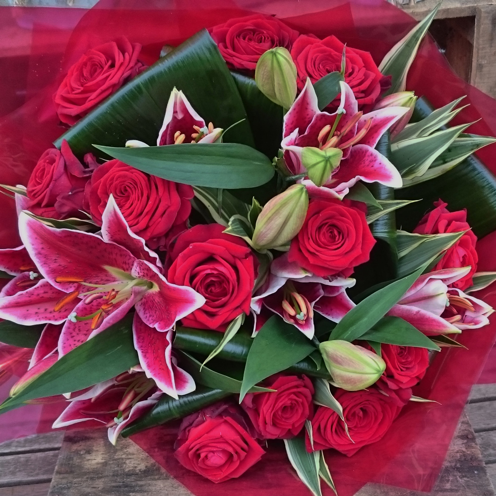 Designer red rose lily hand tied lamberts for Lily rose designer